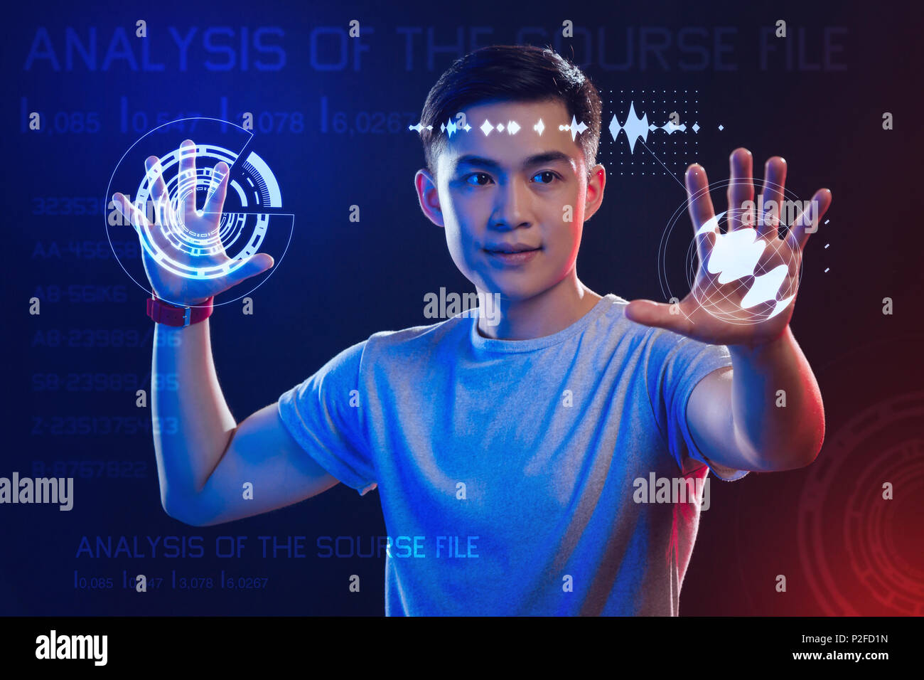 Professional web developer using holograms while working - Stock Image