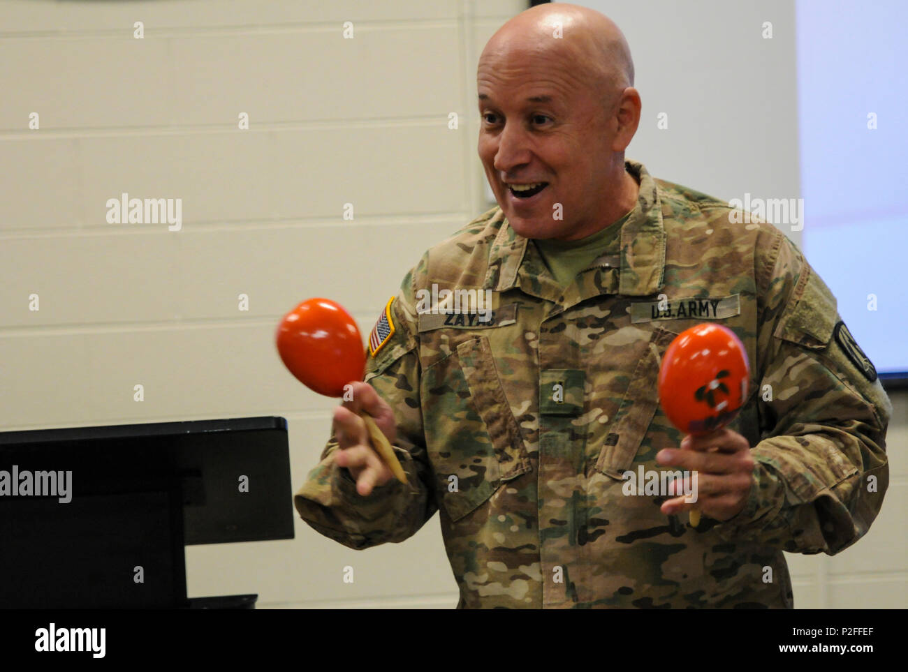 CW5 Miguel Zayas, a Caguas, Puerto Rico native and G36 senior technical advisor, and MSG Marland Williams, the G1 noncommissioned officer in charge, both from the 335th Signal Command (Theater), discuss how to properly play the maracas during the Equal Opportunity Observance in East Point, Georgia Sept. 18, 2016. During battle assembly weekend, the Equal Opportunity Office conducted its annual observance of National Hispanic Heritage Month. (U.S. Army photo by Sgt. Stephanie A. Hargett) (Released) - Stock Image