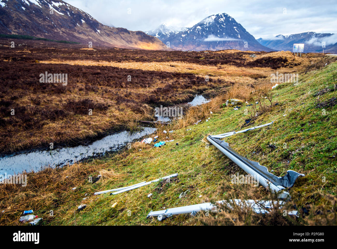 Car parts, caravan awning, plastic and metal dumped in Glen Coe - polluting a world class site of natural beauty in the Highlands of Scotland - Stock Image