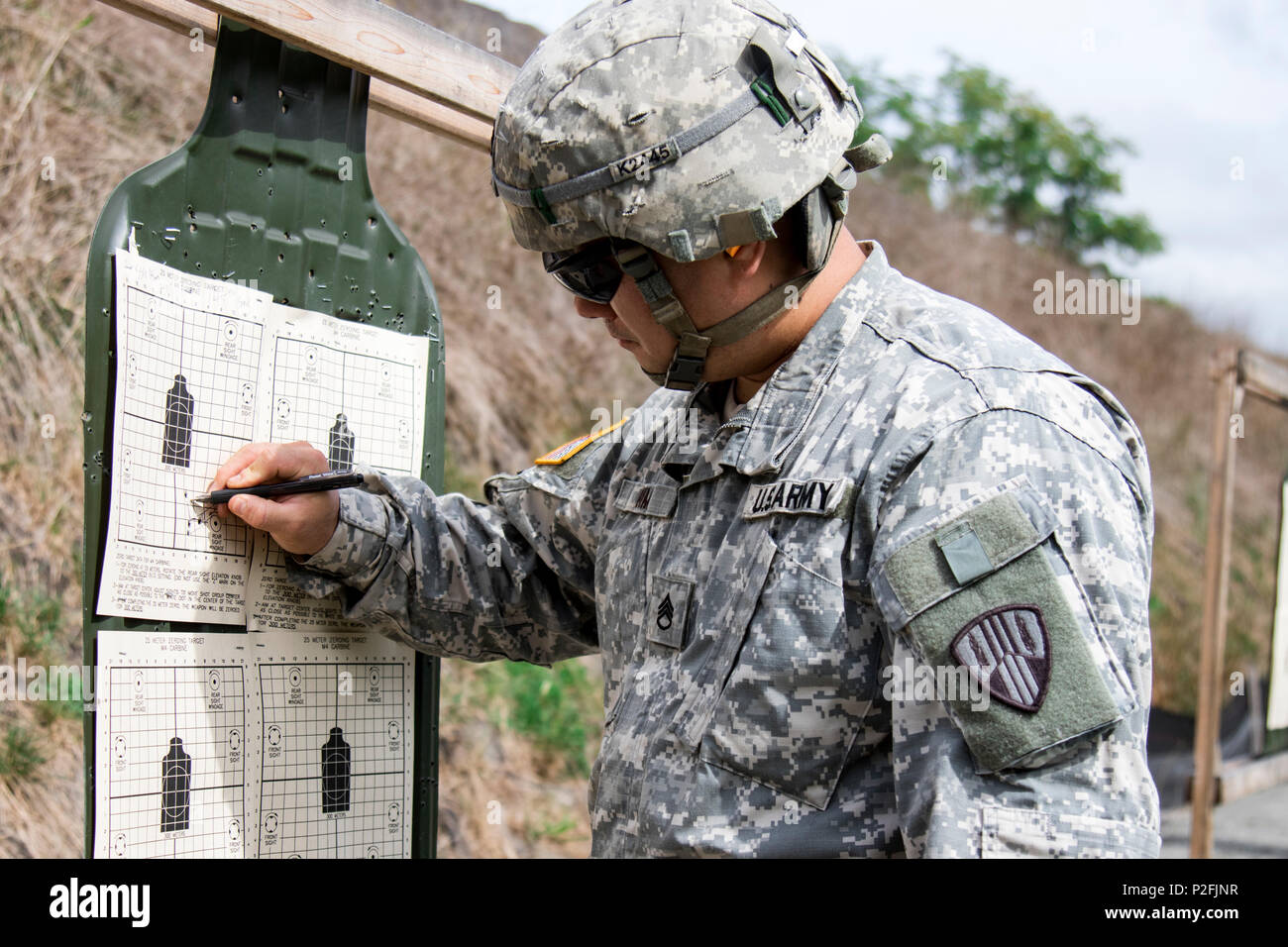 U.S. Army Staff Sgt. James Kim, a quartermaster and chemical equipment repairer assigned to the New York Army National Guard 145th Maintenance Battalion, reviews his zeroing score for the M4A1 Carbine on his target at Camp Smith Training Site, 20 September 2016. The Soldiers were qualifying in order to go on State Active Duty to reinforce Joint Task Force Empire Shield, the New York National Guard security force in New York City, at the direction of Governor Andrew M. Cuomo, in response to increased security concerns in the city following a Sept. 17 bomb attack there. (U.S. Army National Guard Stock Photo