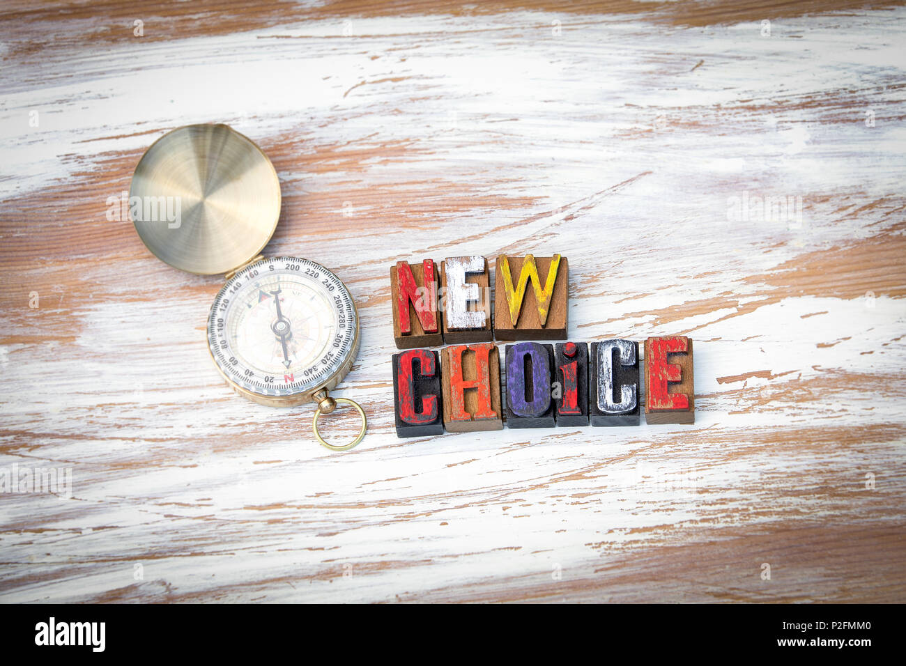 New choice. Wooden letters on the office desk - Stock Image