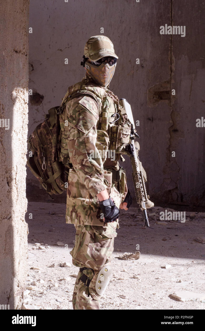 Special forces soldier inside building aim target rifle - Stock Image