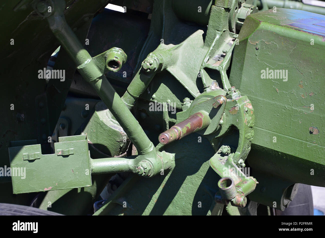 A close-up mechanism of a portable weapon of the Soviet Union of World War II, painted in a dark green color - Stock Image