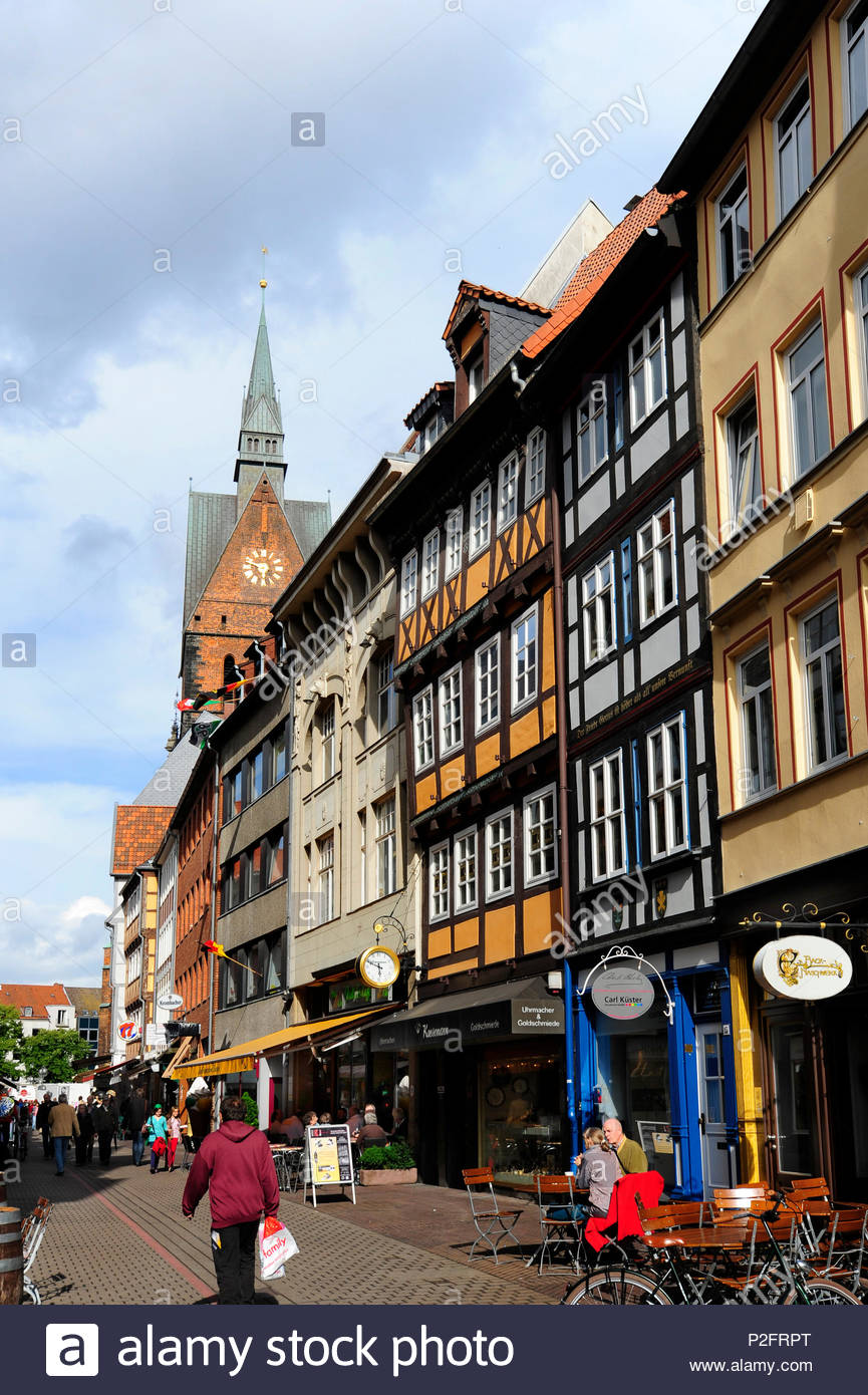 People in the Kramerstrasse, Marktkirche church in the background, historic city centre, Hanover, Hannover, Lower Saxony, German - Stock Image