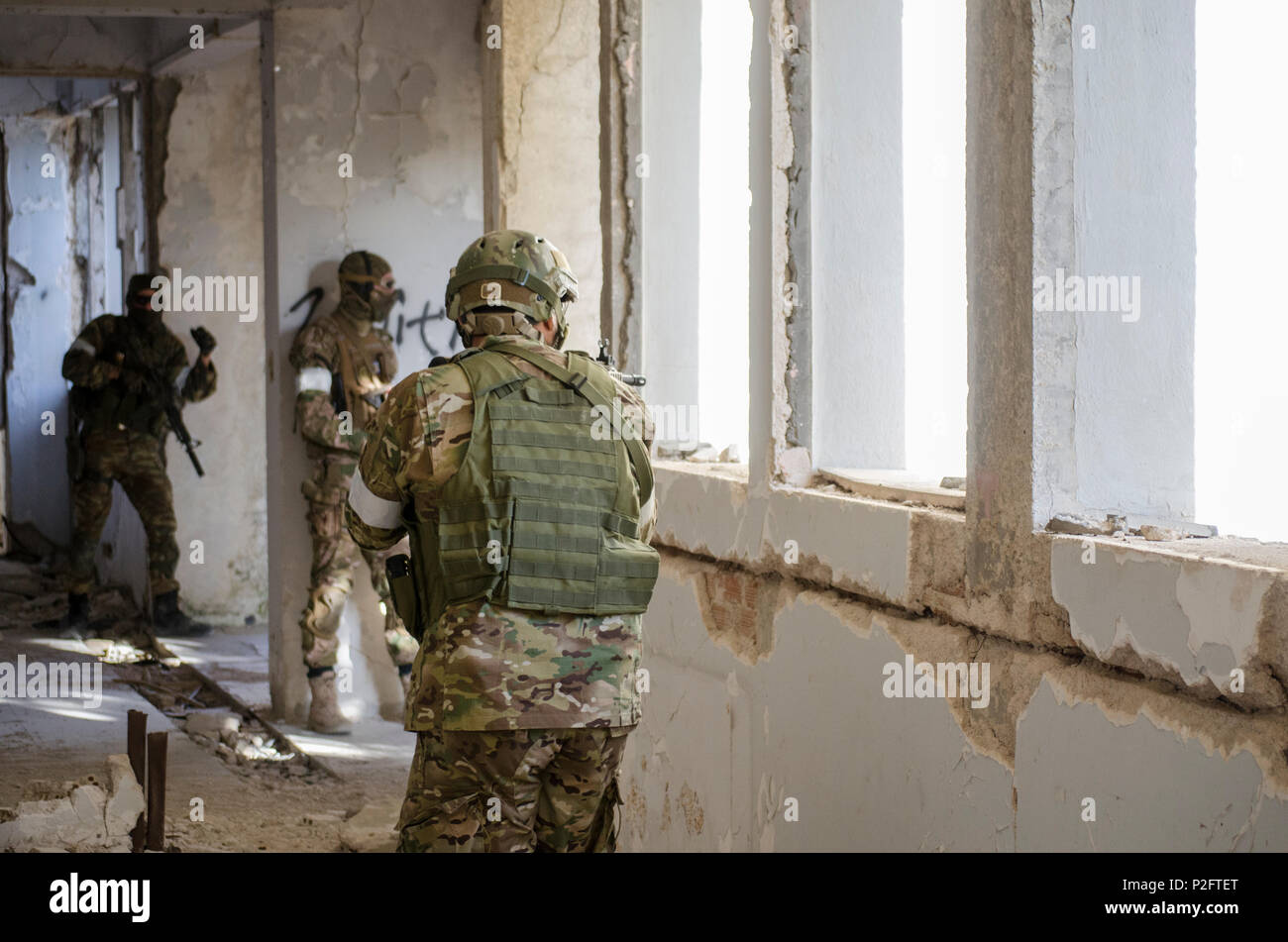 airsoft soldier side view aim target digital uniform camouflage - stock  image