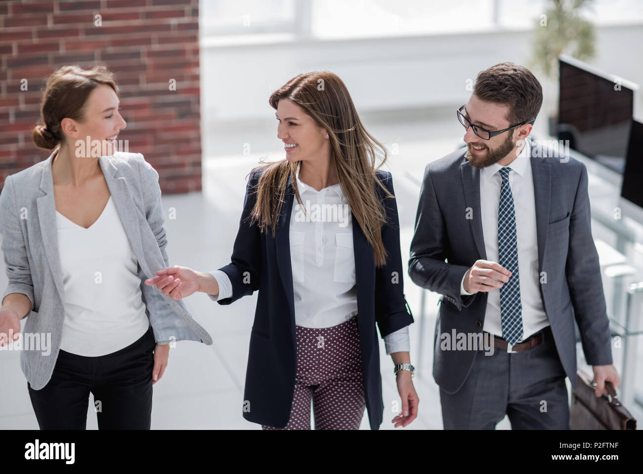 Manager meets customers in the office - Stock Image