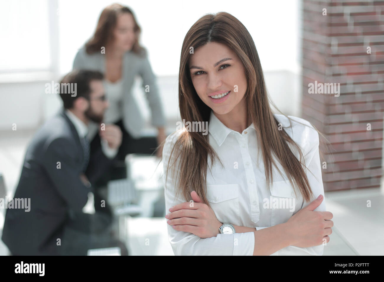 confident business woman at modern office - Stock Image