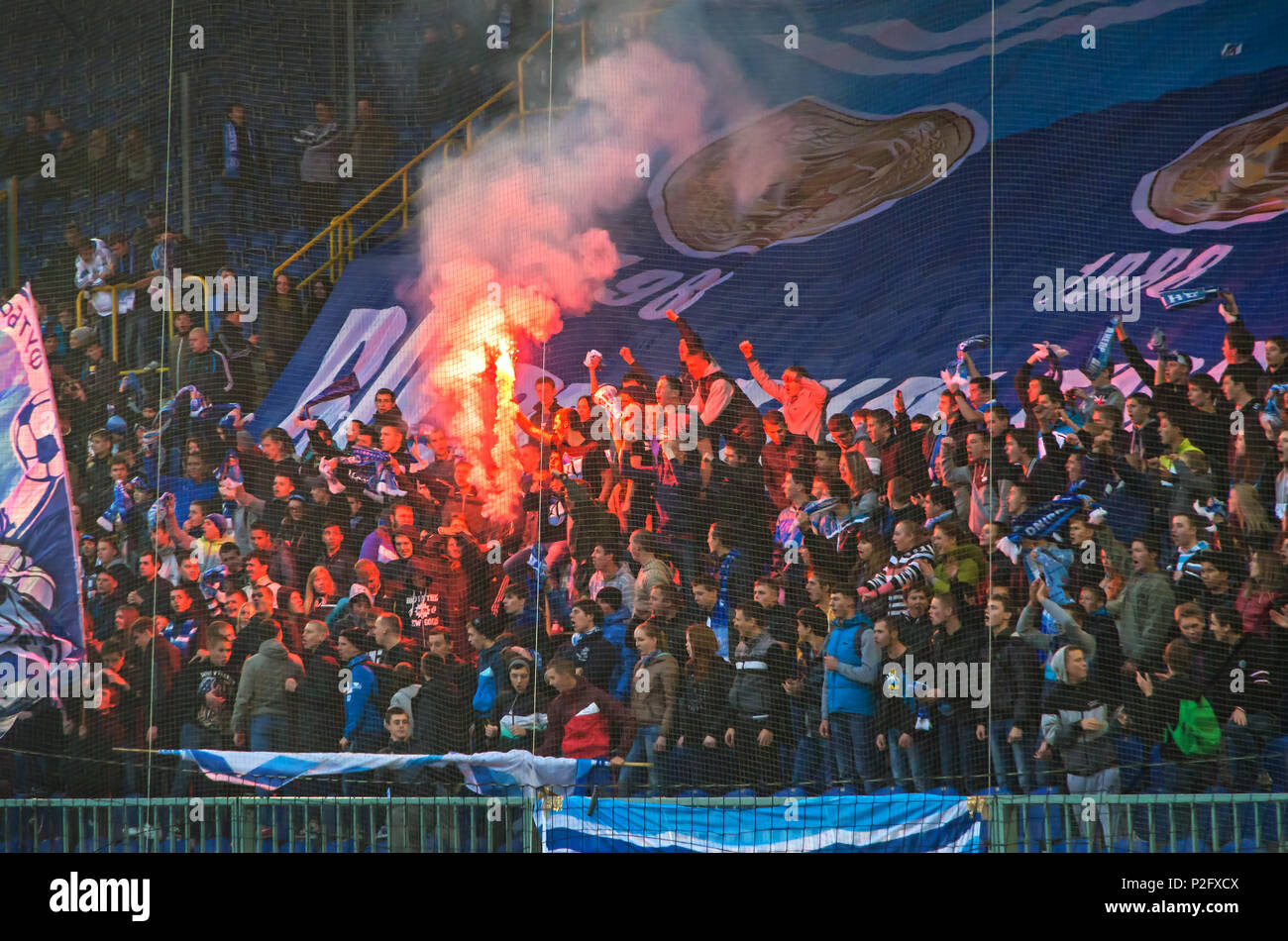 Dnipro, Ukraine - October 12, 2013: Celebrating anniversary of victories of FC Dnipro in USSR Championship in 1983 and 1988. Football hooligans burn f - Stock Image