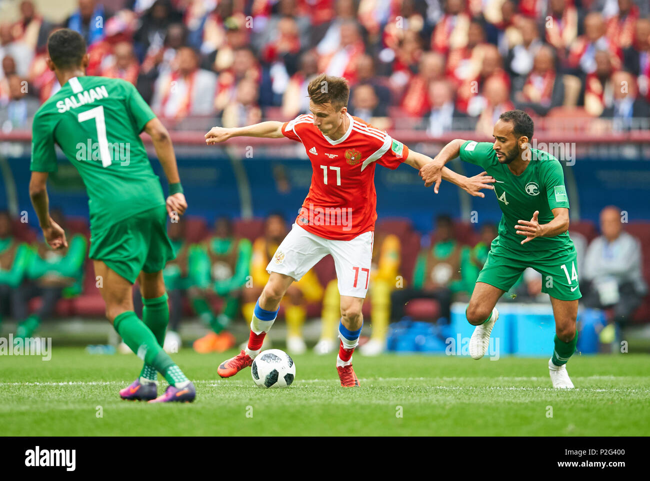 Moscow, Russia- Saudi Arabia, Soccer, Moscow, June 14, 2018 Aleksandr GOLOVIN, Russia Nr.17  compete for the ball, tackling, duel, header against Abdullah OTAYF, Saudi Arabia Nr. 14 Salman ALFARAJ, Saudi Arabia Nr. 7  RUSSIA - SAUDI ARABIA 5-0 FIFA WORLD CUP 2018 RUSSIA opening match, Season 2018/2019,  June 14, 2018 Luzhniki Stadium in Moscow, Russia. © Peter Schatz / Alamy Live News - Stock Image
