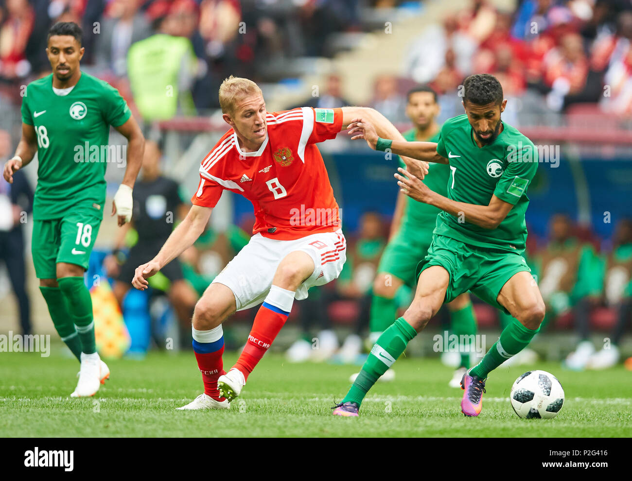 Moscow, Russia- Saudi Arabia, Soccer, Moscow, June 14, 2018 Iury GAZINSKY, Russia Nr.8  compete for the ball, tackling, duel, header against Salman ALFARAJ, Saudi Arabia Nr. 7  RUSSIA - SAUDI ARABIA 5-0 FIFA WORLD CUP 2018 RUSSIA opening match, Season 2018/2019,  June 14, 2018 Luzhniki Stadium in Moscow, Russia. © Peter Schatz / Alamy Live News - Stock Image