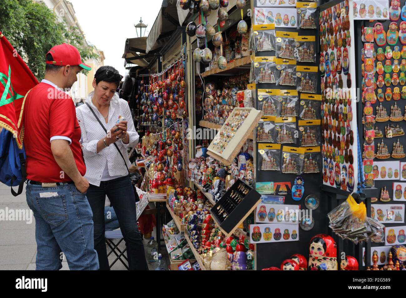 St. Petersburg, Russia, 15th June, 2018. Moroccan football fan buying Russian souvenirs in Saint-Petersburg on the day of first match of FIFA World Cup 2018 in the city. It is the match Morocco vs Iran Credit: StockphotoVideo/Alamy Live News - Stock Image