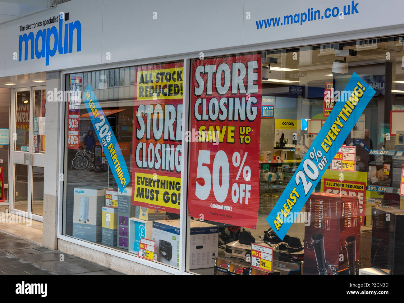a maplin store on the high street offering items for sale closing down.  internet shopping demise of the high street for retailers. store closing down - Stock Image