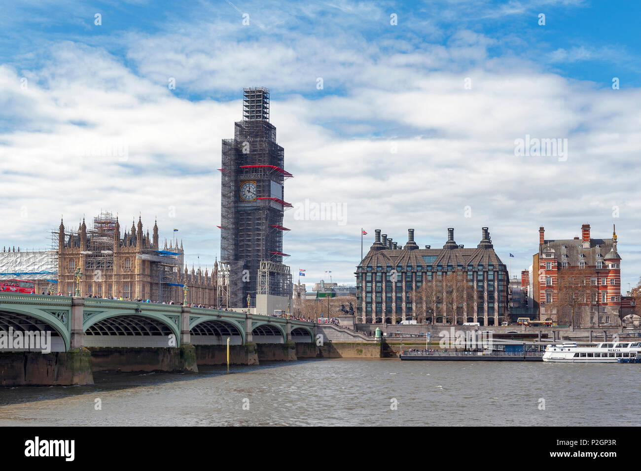 The Elizabeth Tower, known as Big Ben, iconic landmark of London, and the Palace of Westminster being scaffolded during the significant renovation Stock Photo