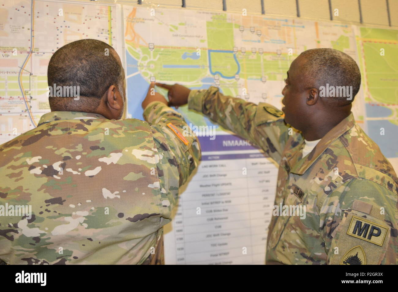 D C  National Guard military police review a map of National