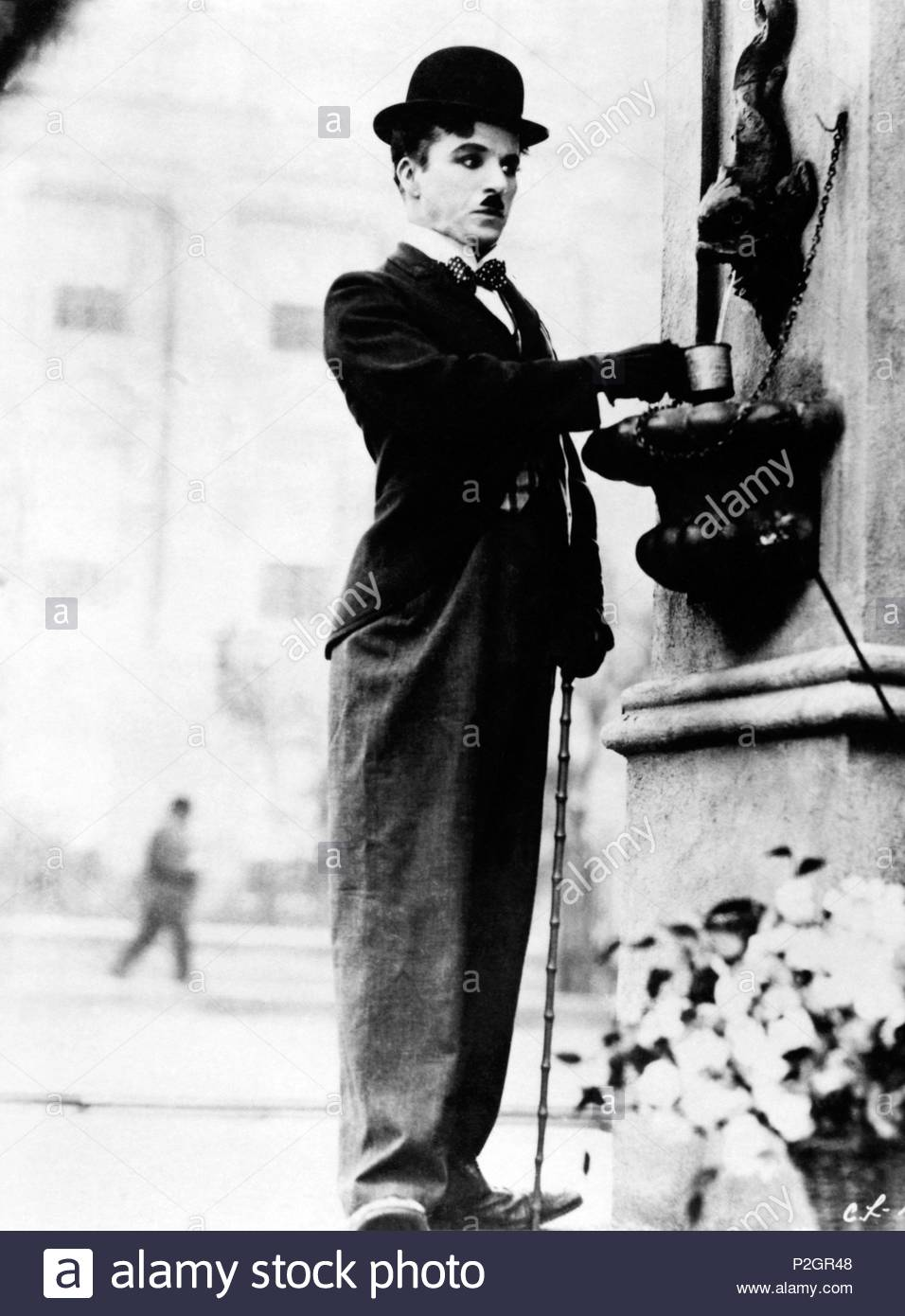 Original Film Title: CITY LIGHTS.  English Title: CITY LIGHTS.  Film Director: CHARLIE CHAPLIN.  Year: 1931.  Stars: CHARLIE CHAPLIN. Credit: UNITED ARTISTS / Album - Stock Image