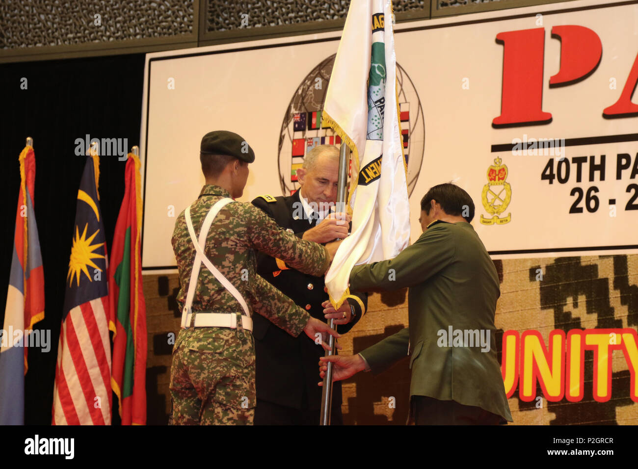 """U.S. Army Gen. Robert B. Brown, Commander, U.S. Army Pacific and Lt. Gen. Dato' Sri Zulkiple, Field Commander West, Malaysian Army post the Pacific Armies Management Seminar Flag during the opening ceremony for PAMS 2016, in Kuala Lumpur, Malaysia, Sept. 26. PAMS is an annual multinational military seminar providing a forum for senior level ground force officers from regional ground forces and security forces to meet, exchange views and discuss professional military subjects. This year's theme is """"Unity of Effort: Building Civil-Military Partnerships to Counter Violent Extremism."""" This seminar Stock Photo"""