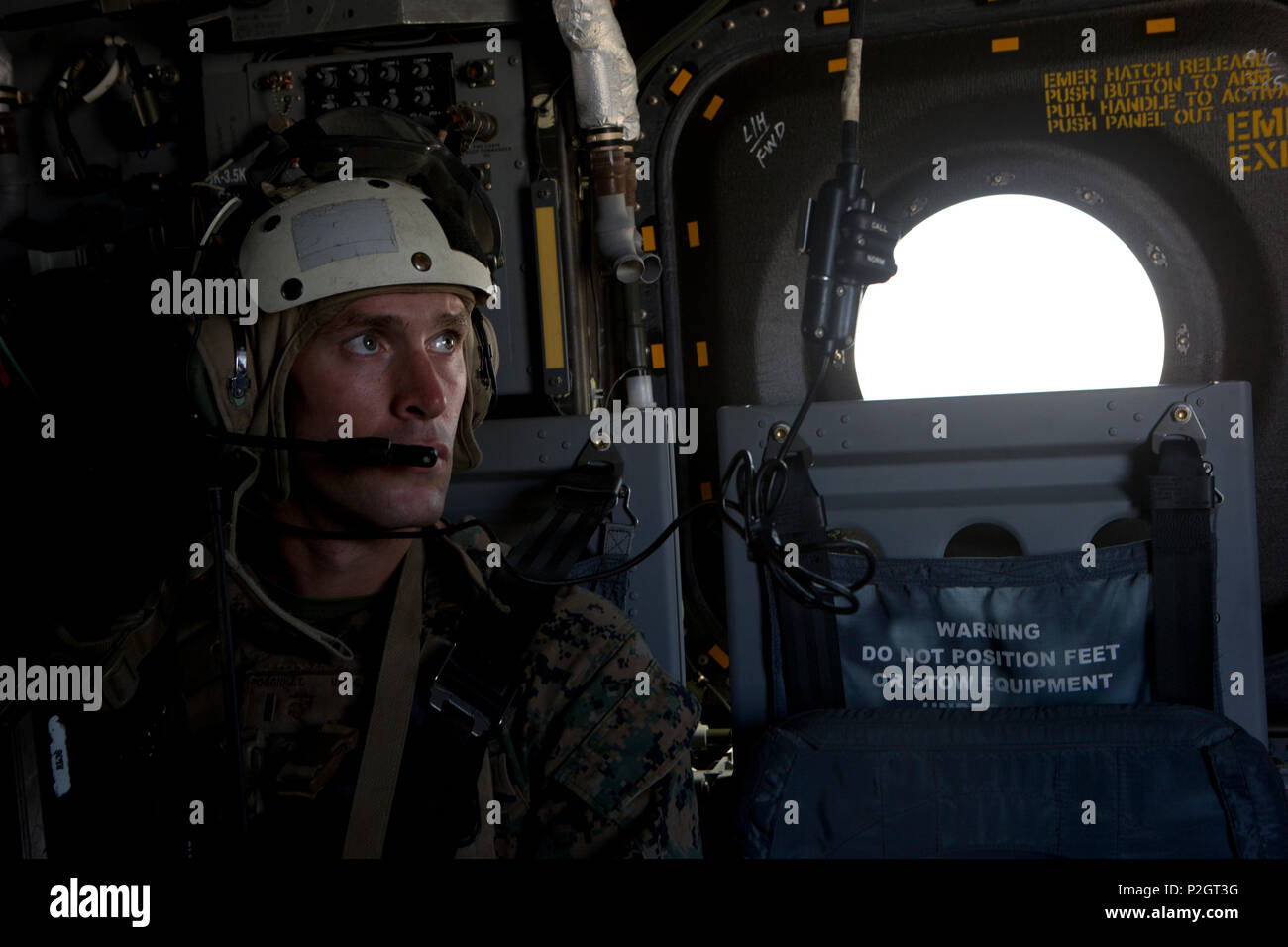 U.S. Marine Corps 2nd Lt. J.T. Poggid attending infantry officers course (IOC) communicates with the pilot during exercise Talon Reach near Yuma, Ariz., Sept. 23, 2016. This evolution provided IOC students exposure to Marine Air Ground Task Force mission planning and execution through the conduct of a long-range, non-combatant, evacuation exercise that extended to both the Combat Center at 29 Palms, Calf. and Marine Corps Air Station Yuma, Ariz. IOC students coordinated with Marine Aviation Weapons and Tactics Squadron One instructors to conduct the command operations center activities, test c - Stock Image