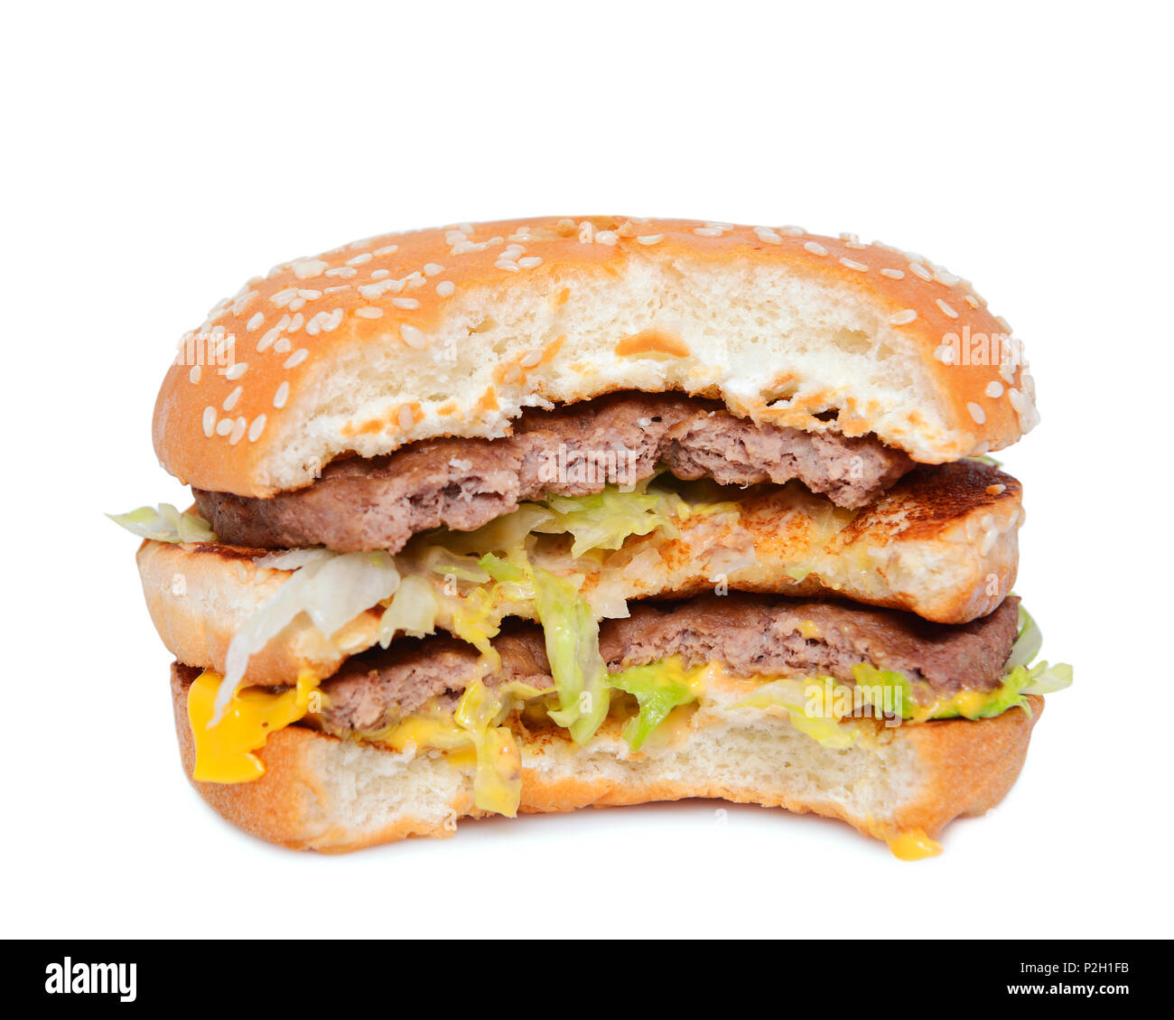 Burger Against a White Background, Close Up - Stock Image