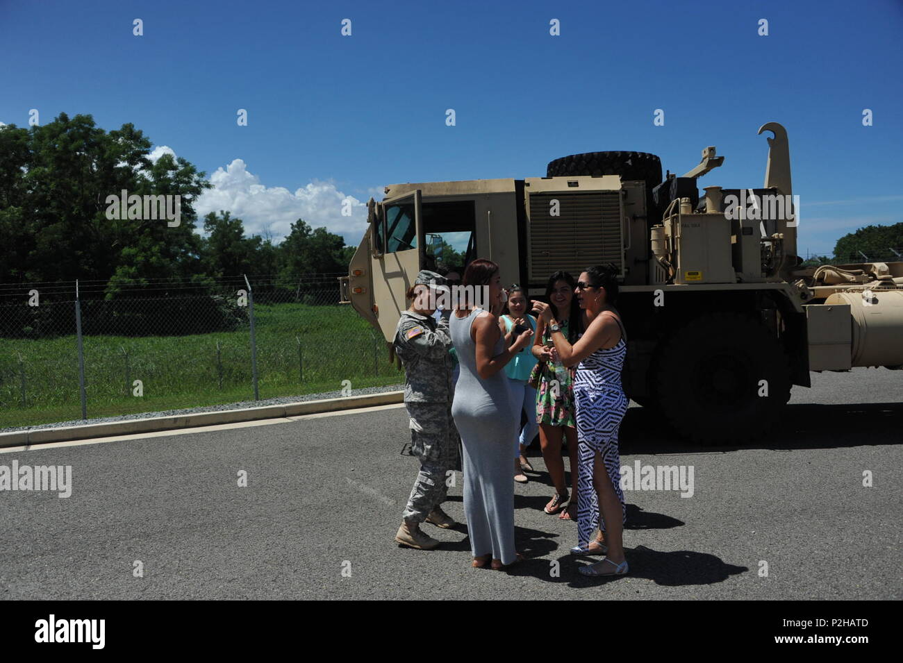 Spec. Valerie Velez and her family share an emotional moment after the 246th Quartermaster Co. (MA) farewell ceremony at the Army Reserve Center at Mayaguez, PR. - Stock Image