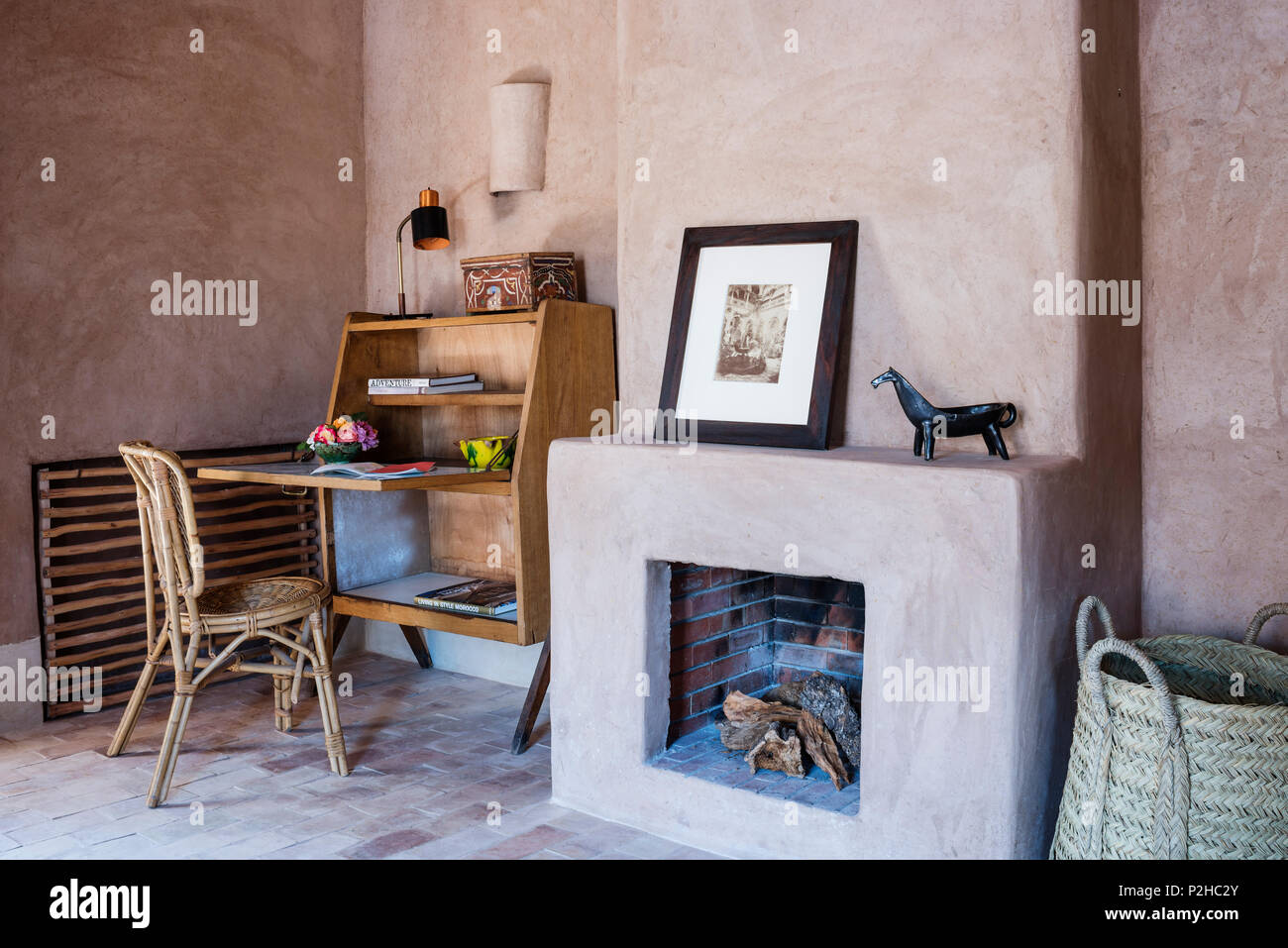 open fire and small 1950s bureau in bedroom with earth walls rh alamy com fireplaces for small rooms gas fire for small room