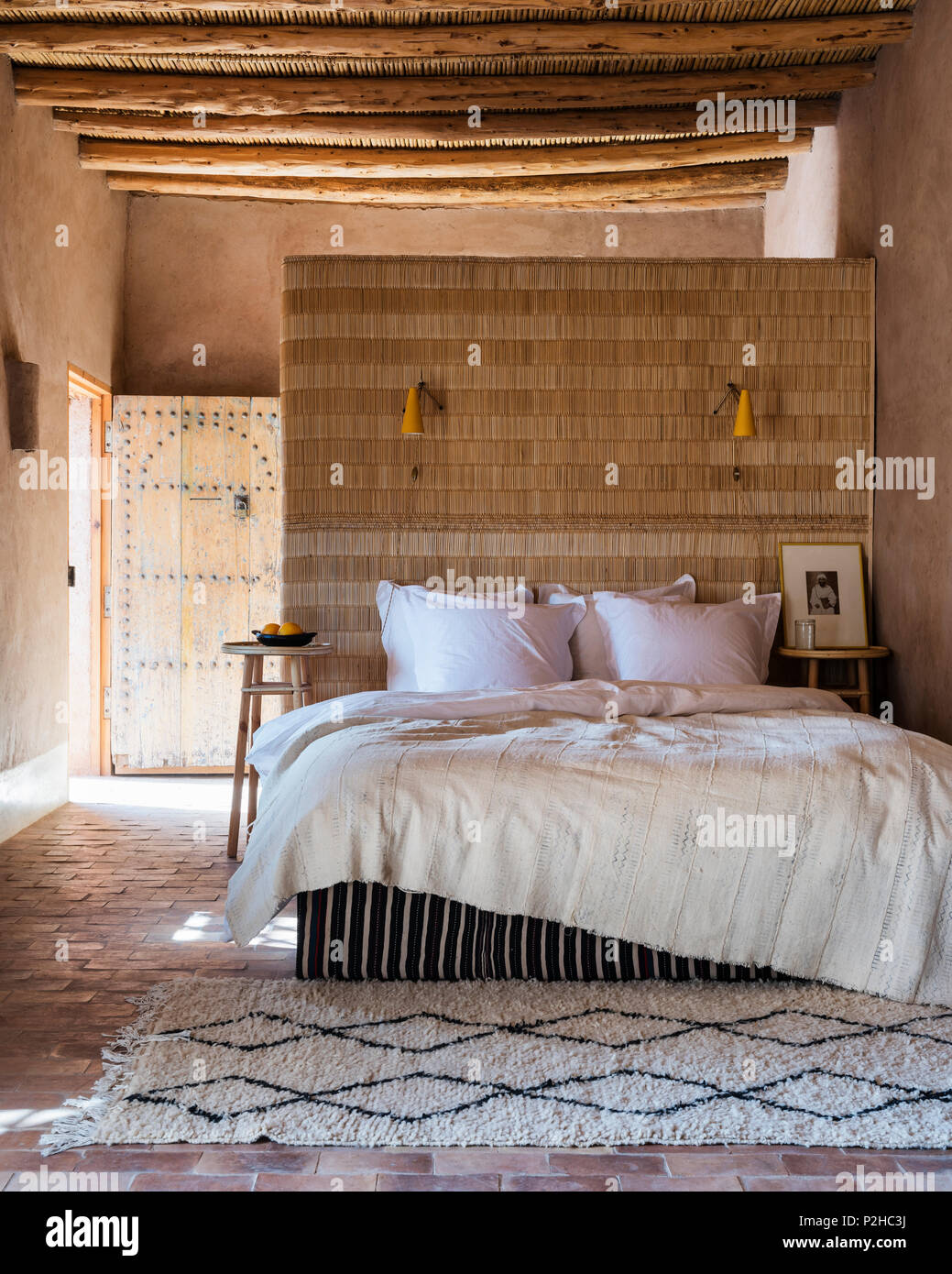 A Rattan Headboard Doubles Up As A Separating Wall In Bedroom With Traditional Wood Berber Ceiling And Terracotta Floors The Beni Ourain Rug Is From Stock Photo Alamy