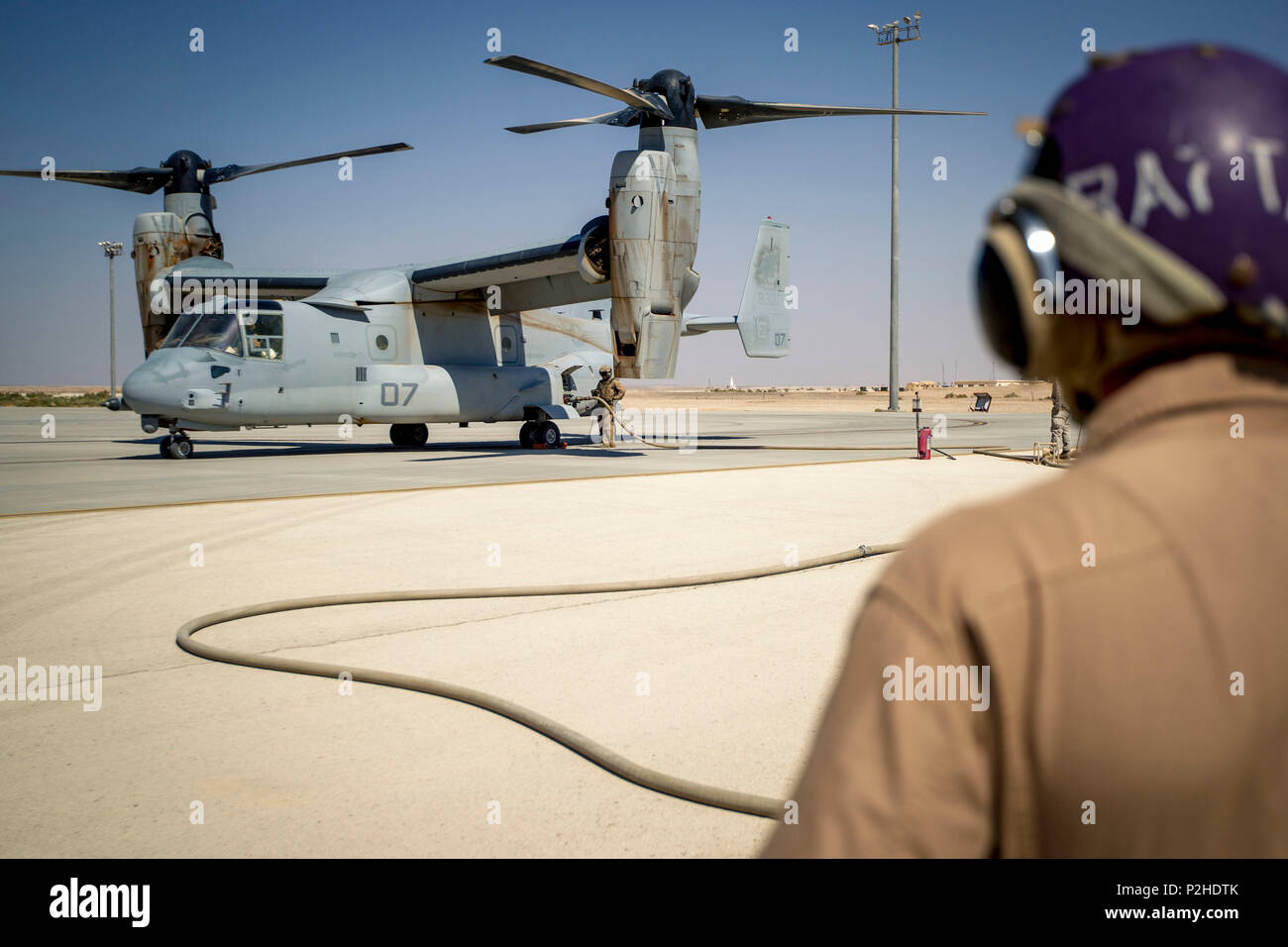 U.S. Marines with Marine Wing Support Squadron 373, Special Purpose Marine Air-Ground Task Force - Crisis Response - Central Command, fuel an MV-22 Osprey at a forward arming and refueling point during a Mission Rehearsal Exercise at a base in southern Jordan, Sept. 10, 2016. The MRX is a collective training event where the MAGTF elements collaborate to refine individual and cooperative capabilities. U.S. Marines and Sailors assigned to Special Purpose Marine Air-Ground Task Force-Crisis Response-Central Command support operations, contingencies and security cooperation in Marine Corps Forces  Stock Photo