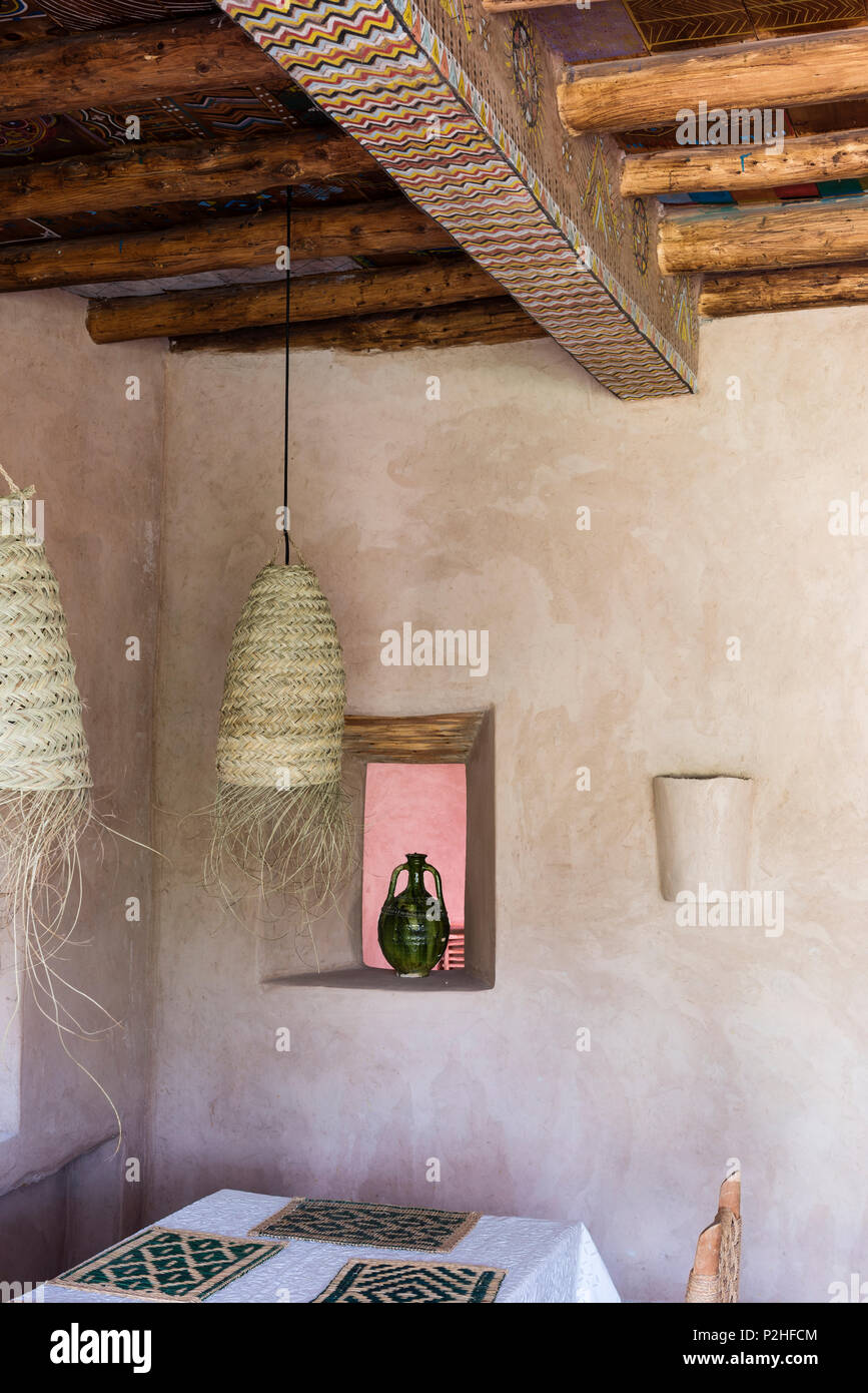 Rattan Pendant Lights Above Dining Table In Berber Style Room With Wood Beamed Ceiling And Earth Walls Stock Photo Alamy