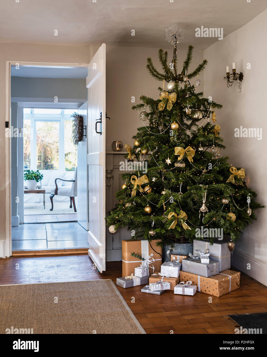 christmas tree decorated with bows and baubles from the. Black Bedroom Furniture Sets. Home Design Ideas