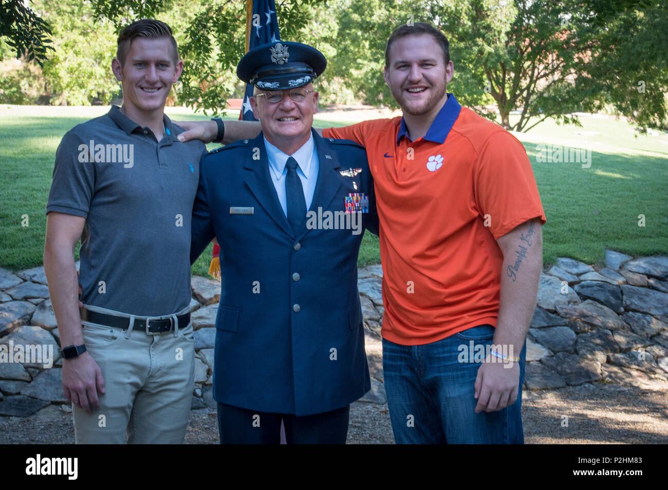 U.S. Air Force Lt. Col. Michael E. Mac Lain embraces his sons, Eric and Sean, after his promotion ceremony at the Scroll of Honor in Clemson University's Memorial Park, Sept. 30, 2016. Mac Lain is the Aeromedical Operations Flight Commander for the 43rd  Aeromedical Evacuation Squadron, Pope Army Airfield, Fort Bragg, NC. He directs daily flight operations for 60 assigned personnel, and provides medical care as a Flight Nurse on aeromedical evacuation missions. Mac Lain has deployed nine times to combat zones and successfully aero medically evacuated over 700 of the most ill and severely injur - Stock Image