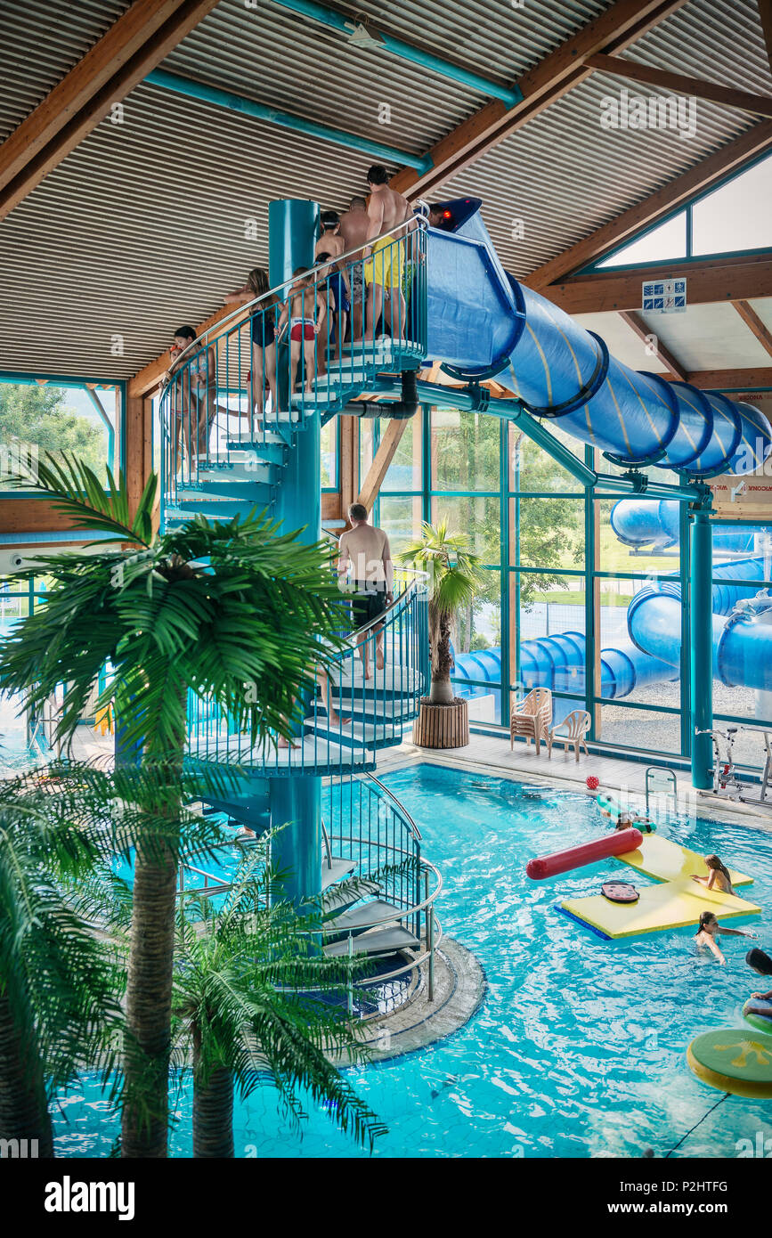 Guests in front of the water slide at the indoor swimming pool, Blaustein, Swabian Alb, Baden-Wuerttemberg, Germany - Stock Image