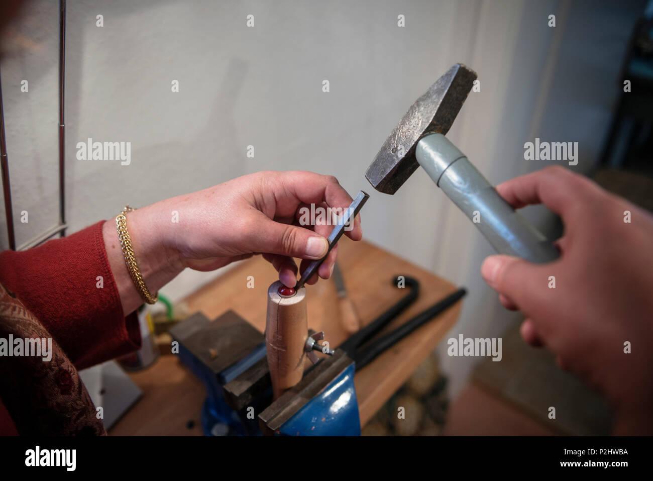 Jeweller inserting a gemstone, Vellberg, Schwaebisch Hall province, Baden-Wuerttemberg, Germany - Stock Image