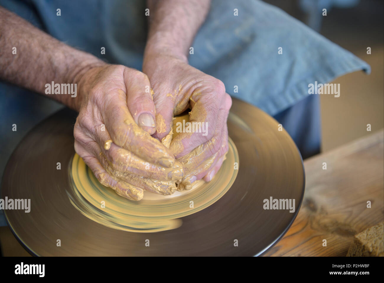 Clay being shaped on a rotating pottery wheel by the potter in the pottery, Vellberg, Schwaebisch Hall, Baden-Wuerttemberg, Germ - Stock Image