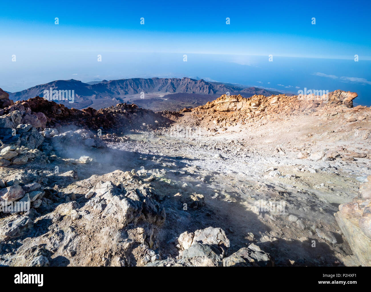 Smouldering summit crater of active volcano Mount Teide with lower caldera rim in the distance on Tenerife the largest of the Canary Islands - Stock Image