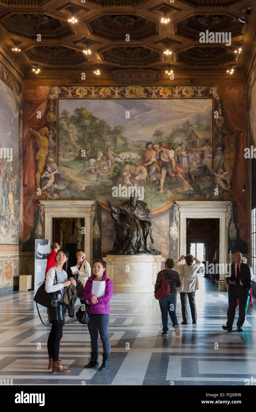 Rome, Italy.  The Capitoline Museum. The Great Hall, also known as the Horatii and Curatii Room.   The fresco on the back wall is Finding of the She-w - Stock Image