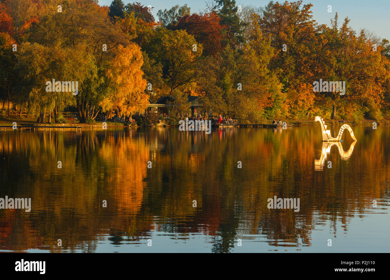 Wesslinger See and lakefront cafe with Nessie sculpture, Autumn, indian summer, Starnberg five lakes region, district Starnberg, - Stock Image