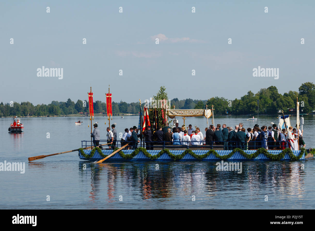 lake prozession on lake Staffelsee, Corpus Christi festival in June, religious tradition, boats crossing to Woerth island, Seeha - Stock Image