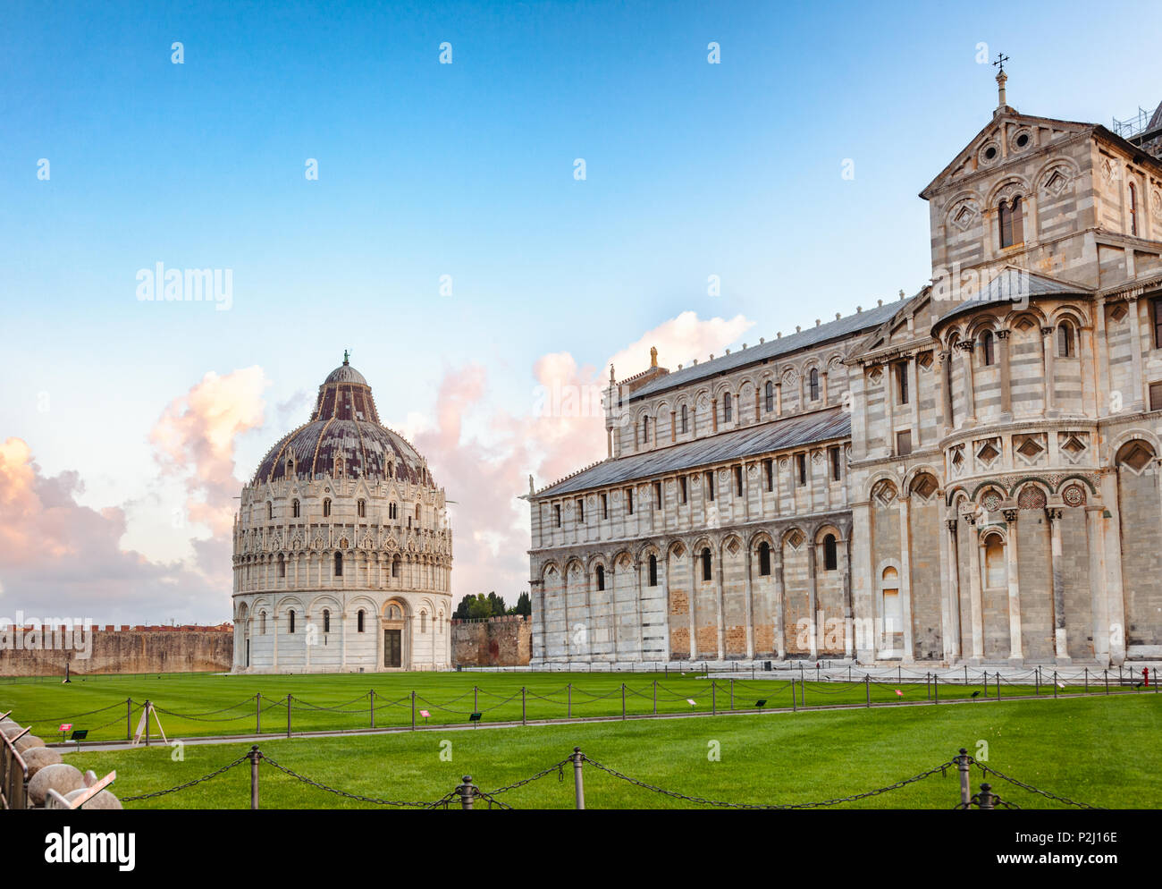 Piazza dei Miracoli (Square of Miracles) or Piazza del Duomo (Cathedral Square) with Pisa Baptistery and Pisa Cathedral in the morning light, Pisa, Tu - Stock Image