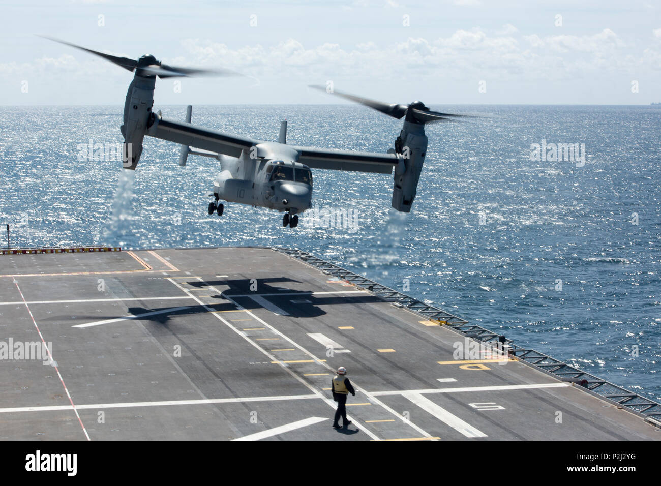 An MV-22B Osprey from Marine Medium Tiltrotor Squadron 266, Special Purpose Marine Air-Ground Task Force-Crisis Response-Africa, takes off from aboard the Spanish amphibious assault ship Juan Carlos I in the Gulf of Cadiz, Spain, Sept. 14, 2016. The Spanish Navy hosted flight deck landing qualifications for SPMAGTF-CR-AF Marines to demonstrate interoperability between the U.S. and Spain. (U.S. Marine Corps photo by Staff Sgt. Tia Nagle) Stock Photo