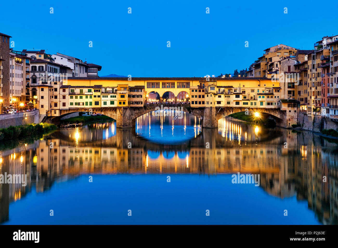 Downriver view of Ponte Vecchio, Florence, Italy - Stock Image