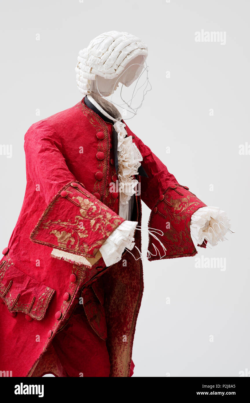 Mannequin wearing paper 18th century style coat - Stock Image