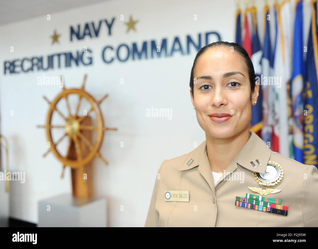 160921-N-WS952-006    MILLINGTON, Tenn. (Sept. 21, 2016) Lt. Evita Salles, director of reserve officer accessions for Navy Recruiting Command, poses for a photo on the command's quarterdeck Sept. 21. Salles was named the winner of the Salute to Active Duty Servicewomen Award by the American Legion Auxiliary at the group's national convention in Cincinnati, Aug. 30. (U.S. Navy photo by Mass Communication Specialist 2nd Class Brandon Martin/Released) - Stock Image