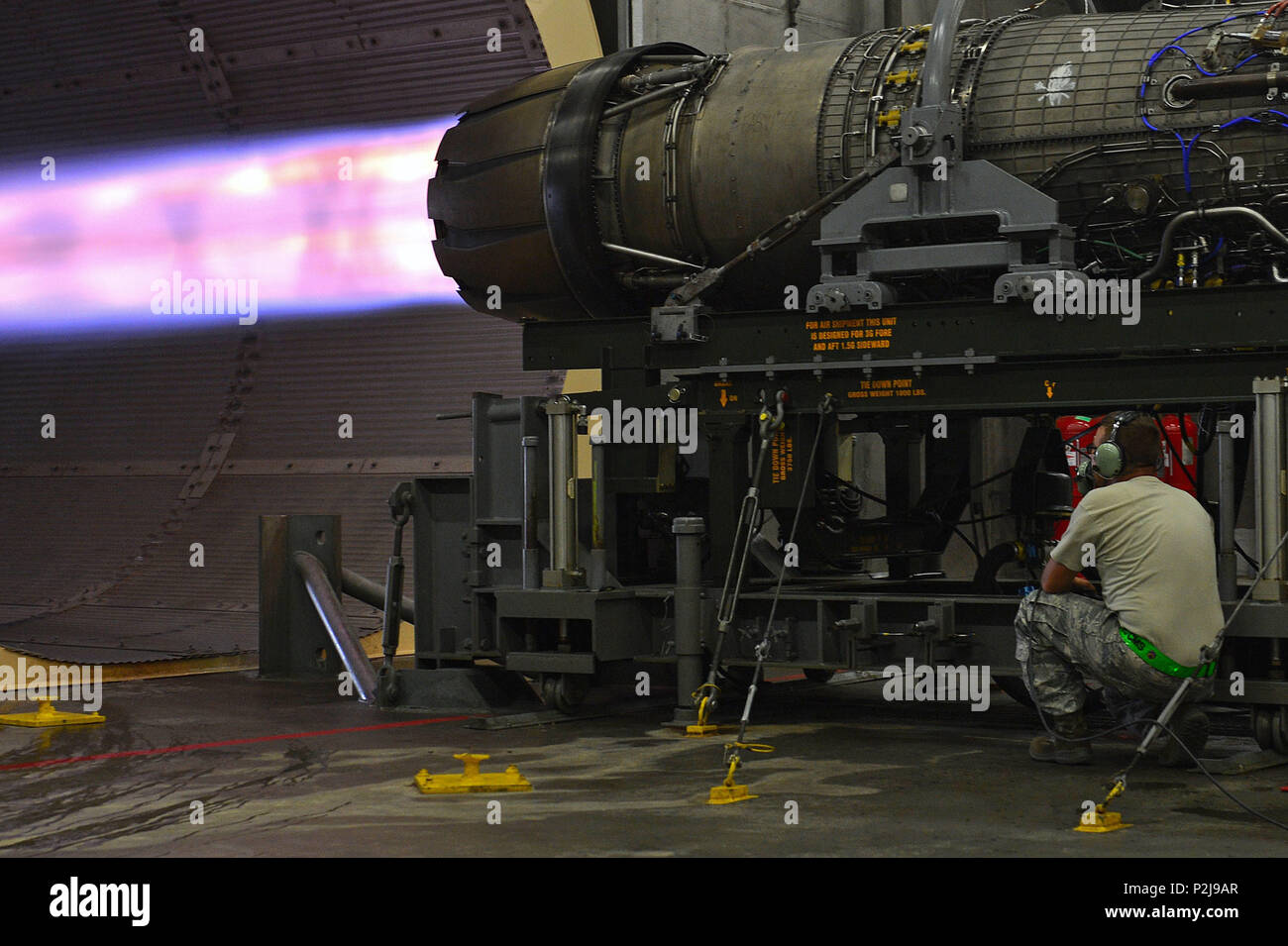 U.S. Air Force Staff Sgt. Dale Rodgers, 20th Component Maintenance Squadron aerospace propulsion craftsman, examines an afterburner during an F-16CM Fighting Falcon engine check at the 20th CMS engine test facility at Shaw Air Force Base, Sept. 26, 2016. An F-16 engine in full afterburn utilizes a thrust of 32,000 pounds to propel it into flight. (U.S. Air Force photo by Airman 1st Class Christopher Maldonado) Stock Photo