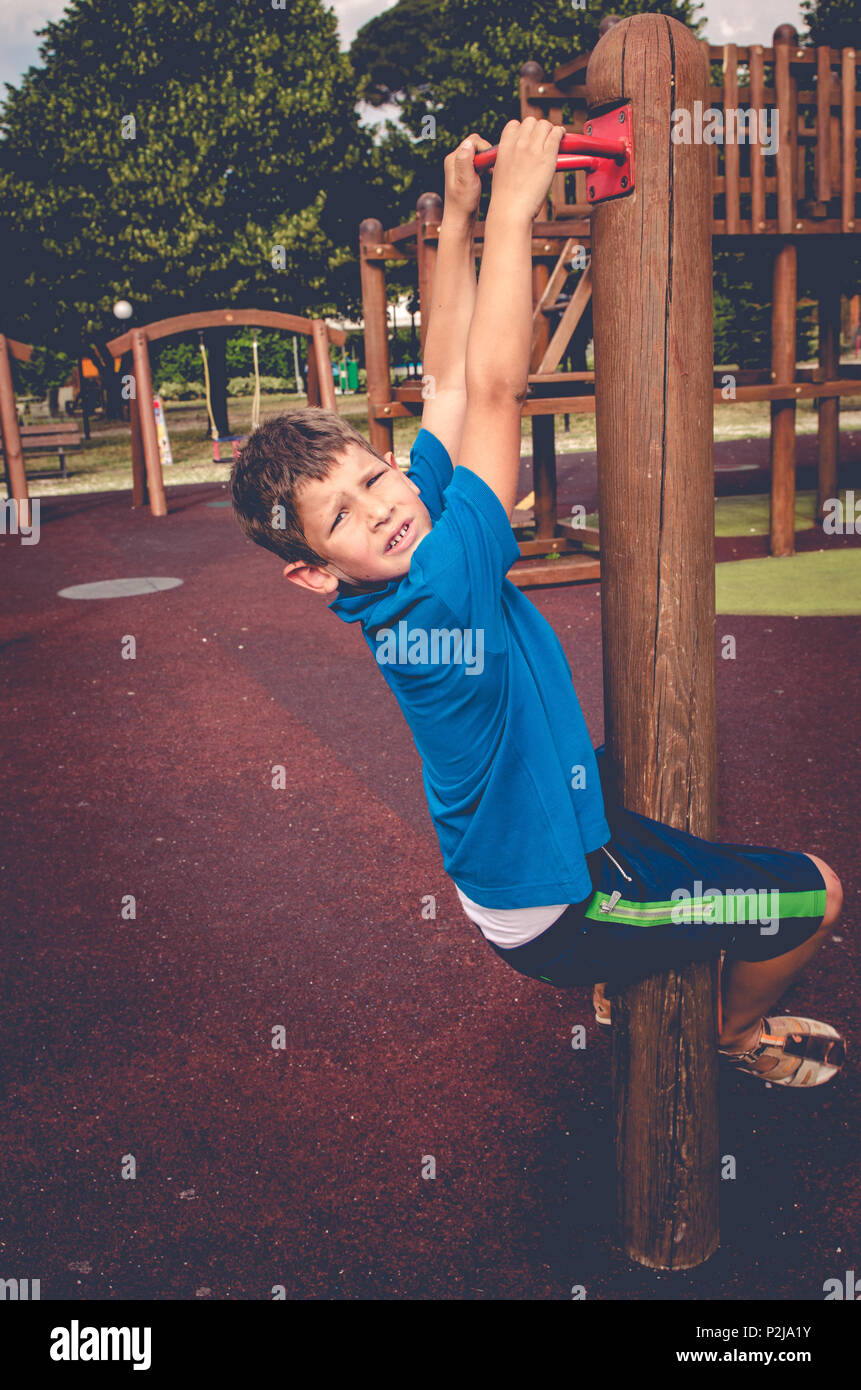 child climbs on games at the playground Stock Photo