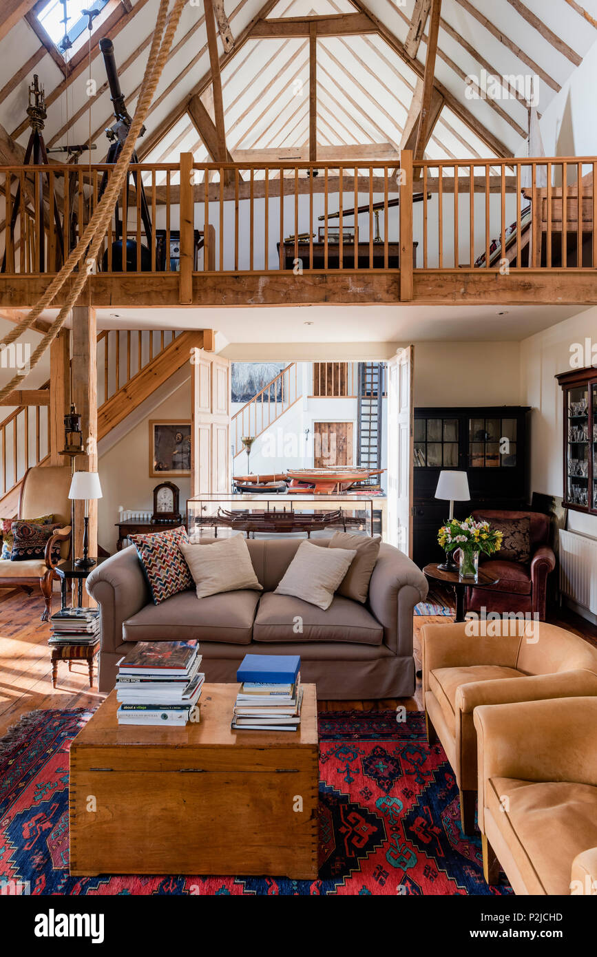 Double height living room with antique telescopes on wooden ...