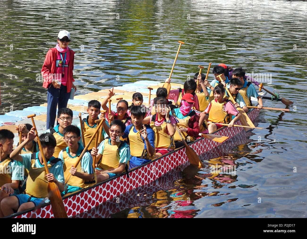 KAOHSIUNG, TAIWAN -- JUNE 10, 2018: A team of junior high school students prepares for the upcoming Dragon Boat Races. - Stock Image