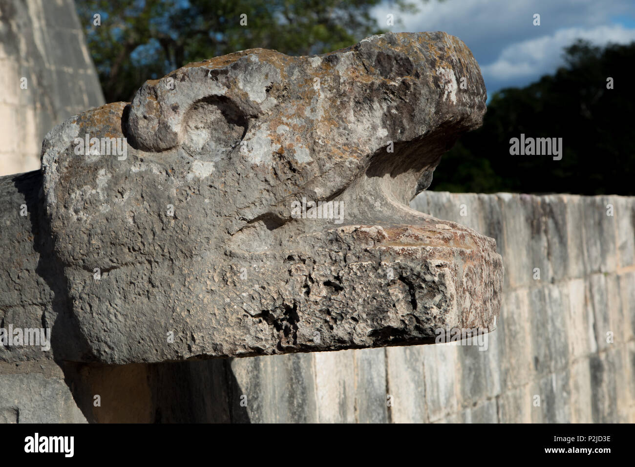 A stone monument to Kukulkan at the Grand Ballcourt of Chichen Itza in Yucatan, Mexico. - Stock Image