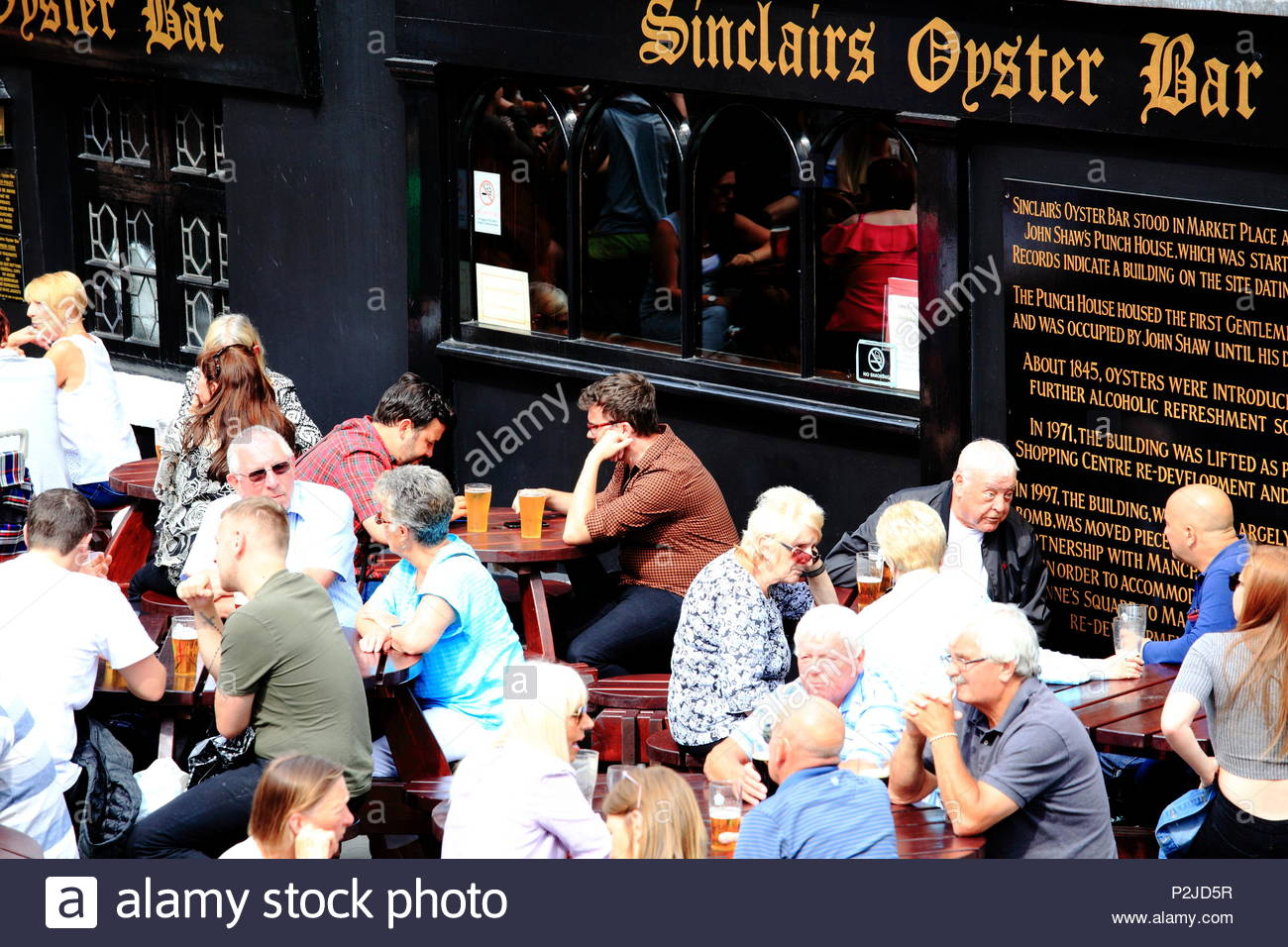 Crowds enjoying an afternoon drink at Sinclairs Oyster Bar at Manchester City Centre, Manchester UK Summer June 2018 - Stock Image