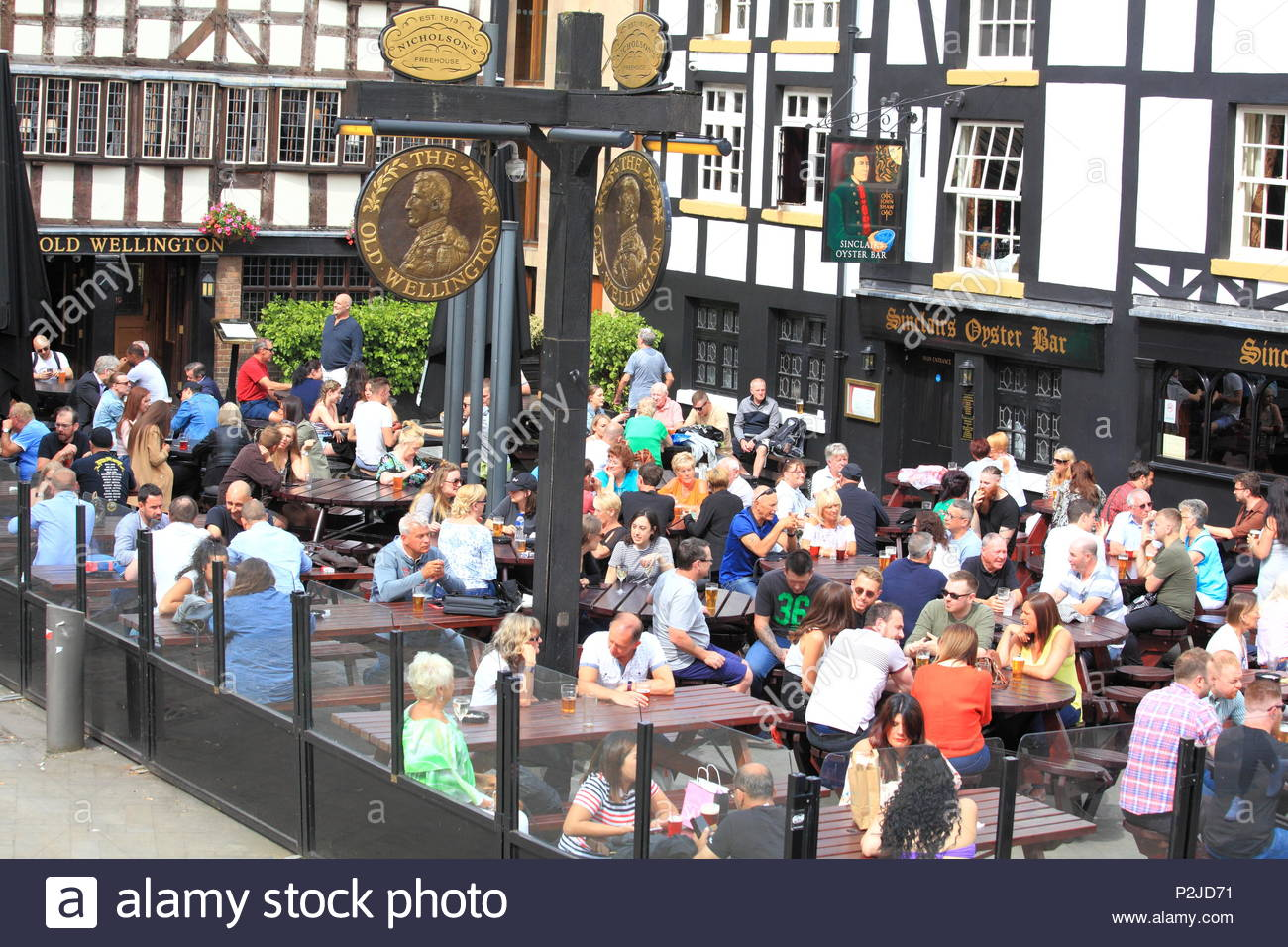 Crowds enjoying an afternoon drink at Sinclairs Oyster Bar at Manchester City Centre, Manchester UK Summer June 2018 Stock Photo