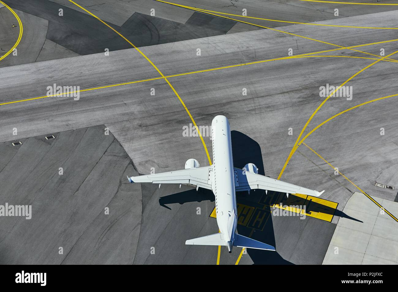 Aerial view of the airport. Airplane taxiing to runway. - Stock Image