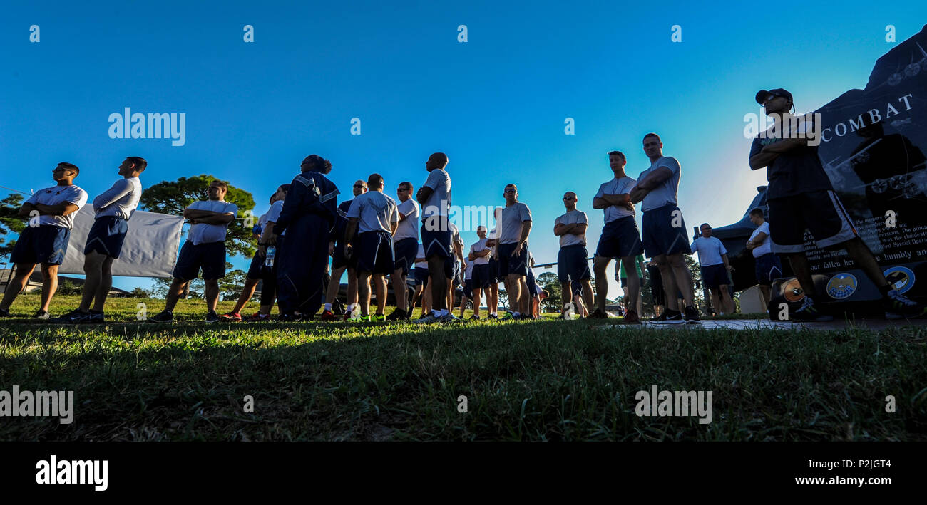 Air Commandos run the Green Dot 5K run at Hurlburt Field, Fla., Sept. 30, 2016. The Green Dot 5k run was used to raise awareness about interpersonal violence within relationships and the workplace. (U.S. Air Force photo by Airman 1st Class Isaac O. Guest IV) - Stock Image